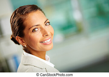 Employer - Portrait of successful business leader looking at...