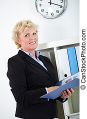 Woman in office - Portrait of smiling middle aged...