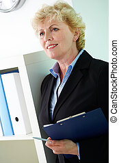Woman with document - Portrait of middle aged businesswoman...