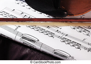 Music - Composition of music notes with string of violin,...