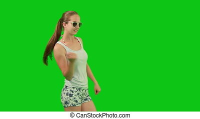 Summer girl in sunglasses dancing