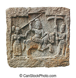 Stone carving of hindu god and godess on a granite stone. The carving was created in 14th century AD during the reign of vijayanagara empire in karnataka in south india. Isolated with clipping mask.