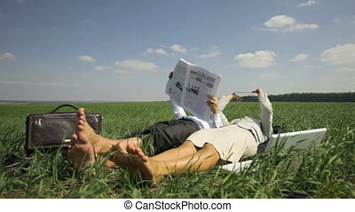 Business on vacation - Relaxed office people lying on the...