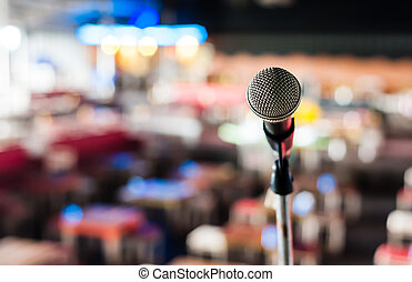 Microphone on stage in club with bokeh background