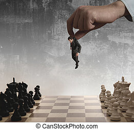 Chess and businessman - A boss uses as a pawn a businessman...