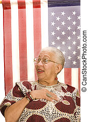 Attractive female American Patriot with flag - Attractive...