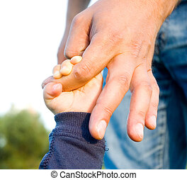 trust family hands of child son and father on field nature...
