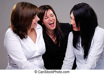 Three Friends - Three Women Having A Good Time Chatting And...