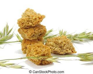 Pao e cereais - Cubos de pao com ervas do campo.