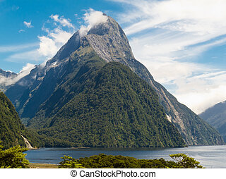 Milford Sound and Mitre Peak in Fjordland NP, NZ - Milford...