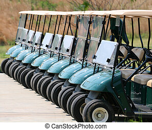 Row of Golf Carts - A row of empty golf carts at a course