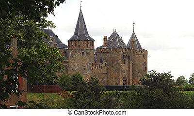 Muiderslot in Muiden - Side view of medieval Muiderslot in...