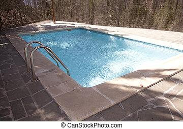 Outdoor swimmingpool - Backyard swimming pool in the sun