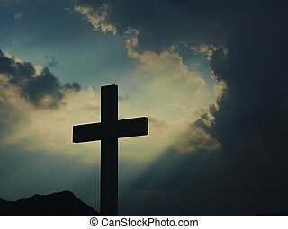 Illuminated Cross - A silhouetted cross illuminated by the...