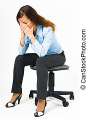 Stress. Woman hides her face in her hands while sitting on...