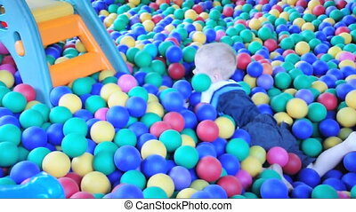toddler playing in the ball-pool