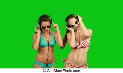Beautiful slim girls dancing