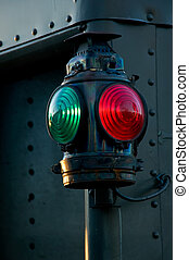 Tail Marker - An antique red and green railroad caboose...