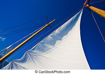 sail - Yacht sail and blue cloudless aky above