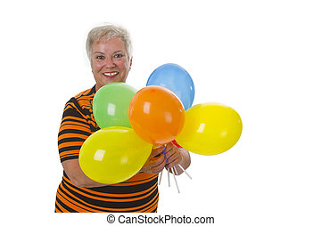 Female senior with colorful ballons - isolated on white...