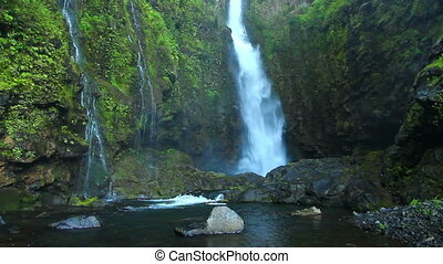 A picturesque waterfall - A beautiful waterfall with three...