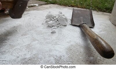 hammer reducing to powder - Artisan with Hammer working raw...