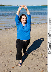 Stretching Out - Plus sized model stretching for fitness on...