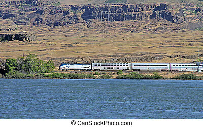 Amtrak Train by the Columbia River - Amtrak passenger train...