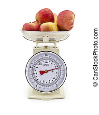 Old style kitchen scales with Apples on white background...