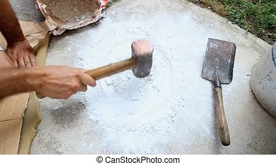 raw material reduced to powder - Artisan with Hammer working...