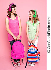 Beautiful teenagers holding school bag - Beautiful teenagers...