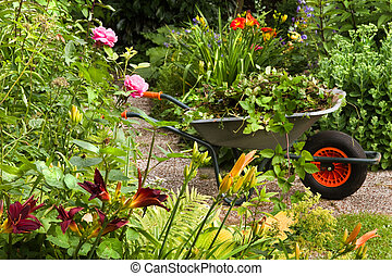 Summer garden with flowers and wheelbarrow - Cleaning up...