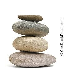 Balancing pebble rocks on white