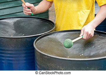 Caribbean style metal steel drums - Closeup of a young...