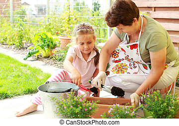 Child helps by replanting