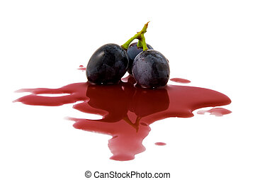 berry grape in a wine puddle