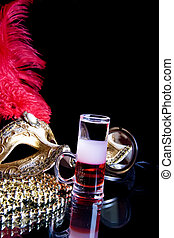 Multi-Layered cocktail and Venetian mask on a black...