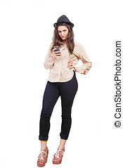 Texting girl - Cute young woman sending text message on...
