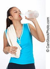 woman drinking water - athletic girl drinking a cold water