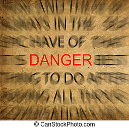 Blured text on vintage paper with focus on DANGER