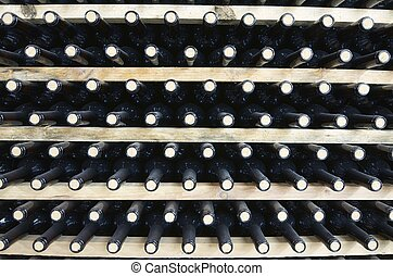 wine - stacked wine bottles to ferment the wine, La Rioja,...