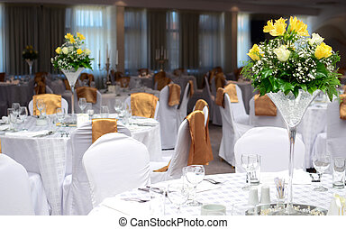 Fancy table set for a wedding with beautiful yellow flowers
