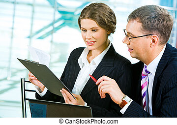 Discussing business plan - Portrait of two colleagues...