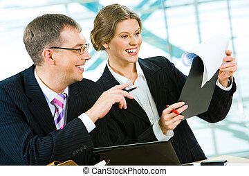 Good idea - Portrait of two smiling businesspeople doing...