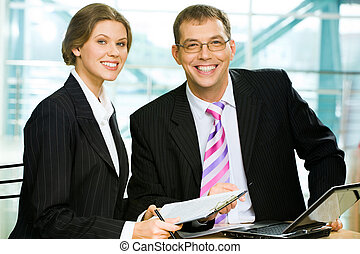 Successful teamwork - Two business people sitting at the...