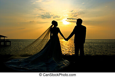 Wedding couple sillhouette at sunset