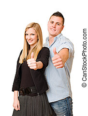 Attractive young couple showing thumbs up. - Portrait of an...