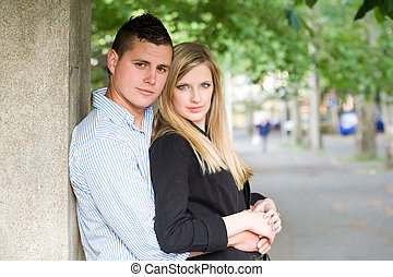 Attractive young couple outdoors - Portrait of a casual...