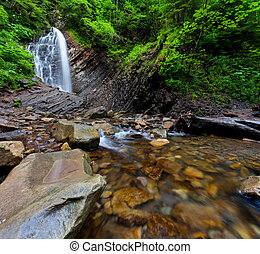 Deep forest waterfall in the mountain