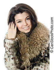 Beautiful girl in a fur hood - The beautiful girl in a fur...